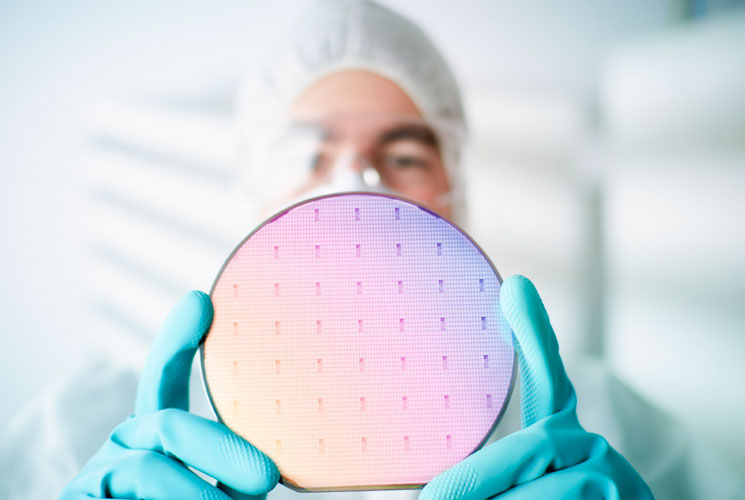 Man holding semiconductor wafer